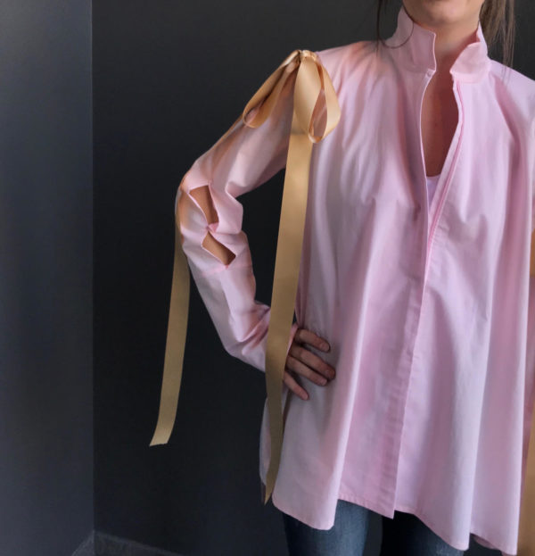 pink cotton blouse with gold bow